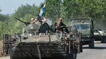 Ukraine says another 13 die in conflict-torn east