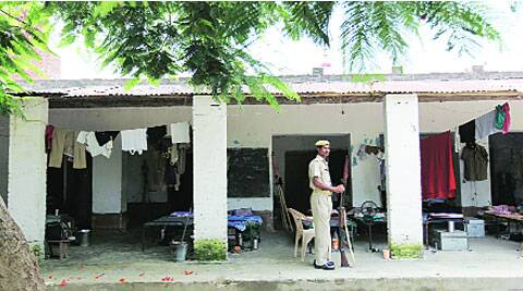 A policeman at Sultania madrasa, Sarawa village, Meerut. ( Source: Express photo by Ravi Kanojia )
