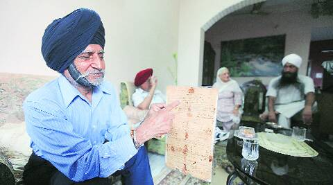 Kulbir Singh Chadha shows the service discharge certificate of his father Sepoy Manna Singh.