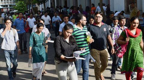 Union Public Service Commission (UPSC) aspirants leave examination centre after their exam in New Delhi on Sunday.