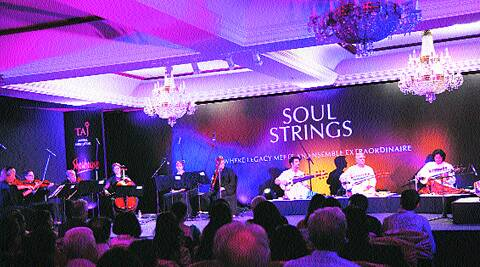 Musicians from the Britten Sinphonia (left) perform with Amjad Ali Khan and his sons.