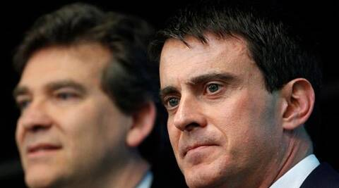 This April 10, 2014, shows French prime minister Manuel Valls, right, and Economy Minister Arnaud Montebourg during a visit to French defense and electronic company Thales in Gennevilliers, outside Paris, France.  (Source: AP photo)
