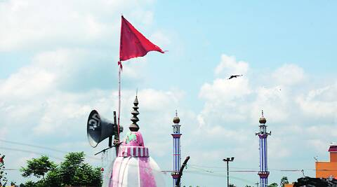 A temple and a mosque in Nehtaur, Bijnor, each with its own loudspeaker. There was a communal incident in the town on July 23. Source: OINAM ANAND