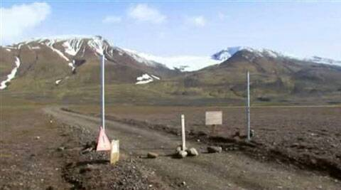 In an in an image from an Aug. 19, 2014 video, a sign is posted on the road next to Bardarbunga, a subglacial stratovolcano located under Iceland's largest glacier.