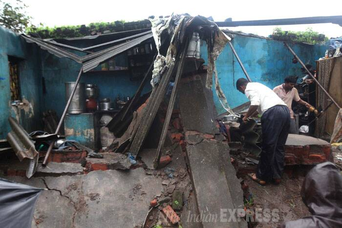 Two women were killed and three others were injured in a wall collapse at Vangani in Mumbai on Monday following heavy rains. (Source: Express photo by  Deepak Joshi)