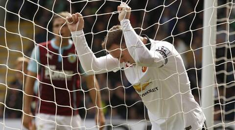 Manchester United's Wayne Rooney reacts after a missed opportunity during their English Premier League soccer match against Burnley (Source: Reuters)