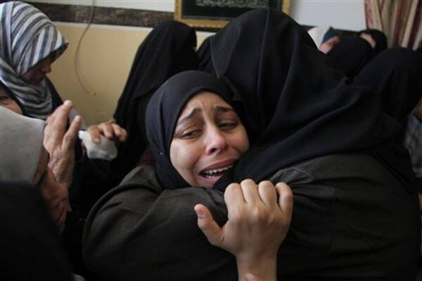 Palestinian relatives weep during the funeral of Ibrahim Hamad, an Islamic Jihad militant, at his family house.