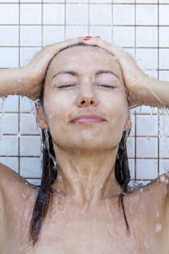 Take a cool bath: It's also important to cool the skin down. But skip the shower. The continual blast of water on your scorched skin will not feel good. Take a bath to cool down the skin gently. Also skip the soap, which will dry the skin out even more.  Instead, add a few scoops of baking soda to your bath. It's cooling and helps your skin retain moisture. (Source: Thinkstock Images)