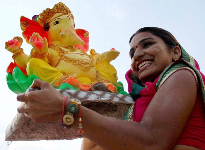 A devotee carries a Ganesh idol ahead of Ganesh Chaturthi festival in Ajmer on Thursday. (Source: PTI)