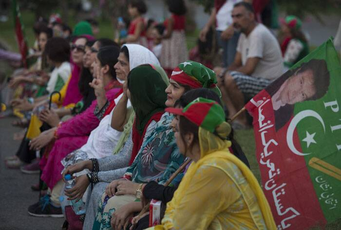 Supporters of Pakistan's cricket-turned-politician Imran Khan wait to march to the Parliament in Islamabad. (Source: AP)