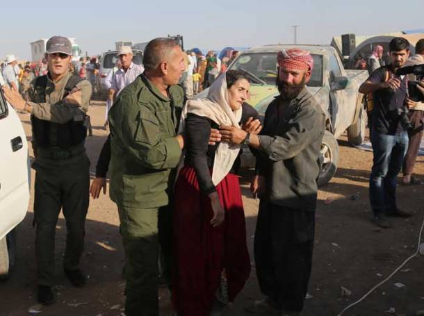 For embattled Iraqi Yazidis, Syrian Kurdish fighters are new heroes