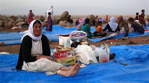 Displaced Iraqis from the Yazidi community settle at a camp at Derike, Syria, Sunday. Source: AP photo