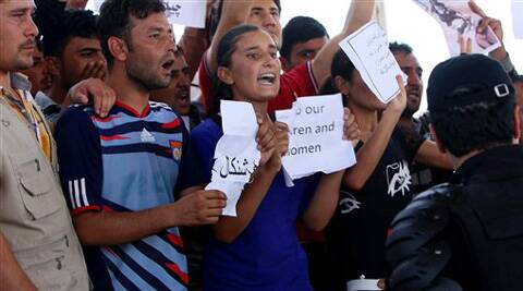 Iraqis from the Yazidi community chant anti Islamic militants slogans in front of UN headquarters to ask for international protection in Irbil, Iraq, Monday, Aug. 4, 2014. (Source: AP)