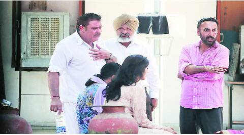 Yograj Singh and Bhupinder Singh with others at Sector 5 Police Station in Panchkula on Monday. ( Source: Express photo by Jasbir Malhi )