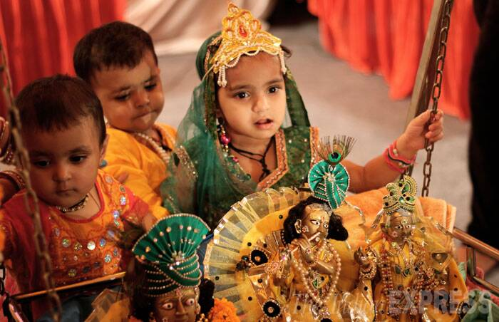 Kids dressed up as Lord Krishna and Radha during the Janam Ashtami celebrations, in New Delhi.  (SourcE: Express photo by Ravi Kanojia)