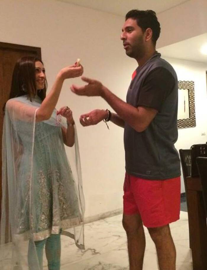 "Sharing another pic, he wrote: ""Sister no 2 for the Rakhi day ! Lisa bocarro mere behen khush reh ! Ladoo khila Aur paise le ja."" (Source: Facebook)"