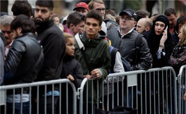 Buyers in Germany line up to buy the new iPhones.