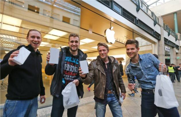 Fans pose after buying their new iPhones in Germany.