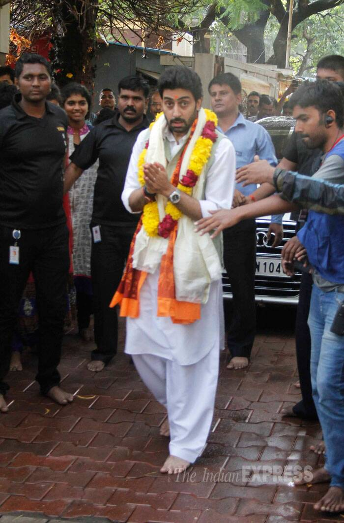 Abhishek, who was seen in white pathani suit, comes out of the temple.  (Source: Varinder Chawla)