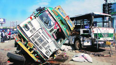 A truck turned over and hit a bus in Noida Sector-71 on Monday. (Source: Express photo by Gajendra Yadav)