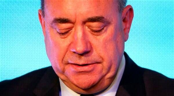 Scottish First Minister Alex Salmond looks down during a press conference in Edinburgh in Scotland on Friday. (Source: AP)