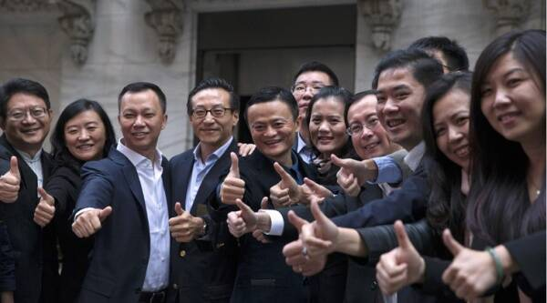 Alibaba Group Holding founder Jack Ma and Joseph Tsai, vice chairman and co-founder, pose with employees as they arrive for the company's IPO at the NYSE in New York. (Reuters)