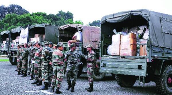Relief material being loaded into trucks at the Army station in Ludhiana on Wednesday. (Source: IE phot by Gurmeet Singh)