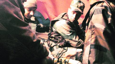 Passing the time, playing chess inside the soldiers' tent at Khanabal Post, during a break in patrolling. Source: Praveen swami