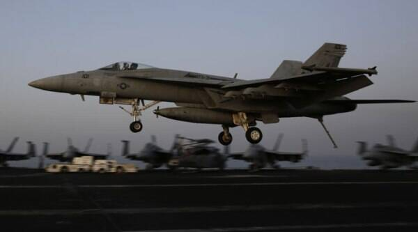 FILE - In this Sunday, Aug. 10, 2014, file photo, a fighter jet coming from Iraq lands on the flight deck of the U.S. Navy aircraft carrier USS George H.W. Bush, in the Persian Gulf. (Source: AP)
