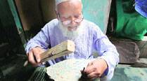 With Wood Intentions: Mohammad Ayyub carves calligraphy on woodenblocks