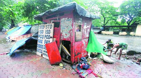 After years of neglect, this shed for BEST staffers at the Mantralaya bus stop has become an extension of the pavement dwellers' homes. It also serves as a storage space for their belongings. (Source: Express photo by Vasant Prabhu)