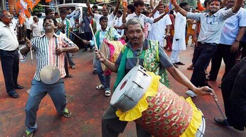 BJP activists dance in-front of their party office to celebrate their victory in Basirhat Dakshin Constituency in State Assembly by-election in Kolkata on Tuesday. (Source: PTI)