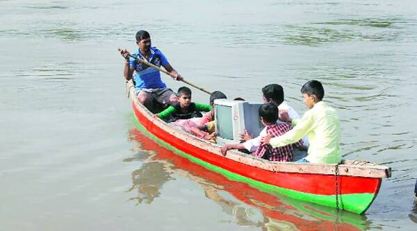 Students of Thane Zilla Parishad School in Saga village of Bhiwandi taluka on Thursday took a television set by boat across the Kalu river from Atali to Nandkar, from where they carried it to school.