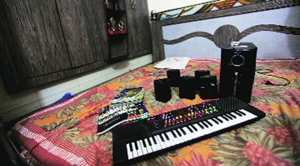 The boy's sister had gifted him a mike and a keyboard; he wanted to join a music school. Source: Ravi Kanojia