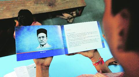 A class VIII student of Shahpur municipal school in Ahmedabad reads from Asmita Darshan, a booklet distributed in all government schools. (Source: PTI photo)
