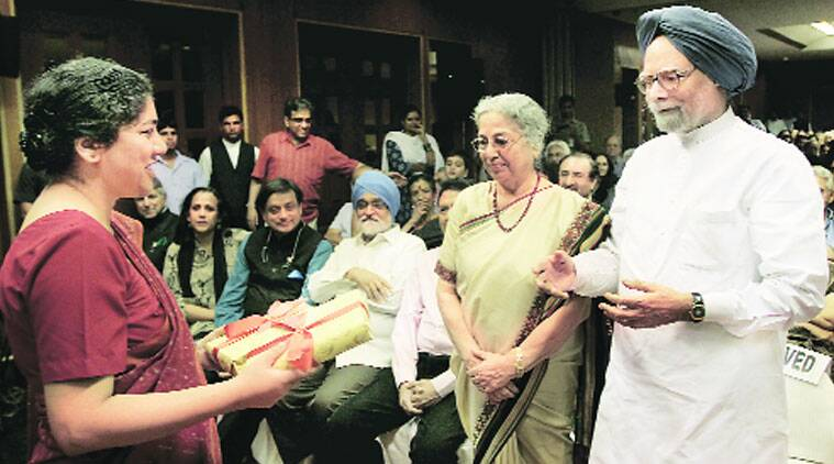Daman Singh presents copies of her book to her parents, in New Delhi on Sunday. (Source: Express photo by Ravi Kanojia)