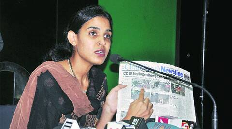 Sukhmani Cheema shows a copy of Chandigarh Newsline while answering questions during a press meet at Chandigarh Press Club on Wednesday. ( Source: Express photo by Sahil Walia )