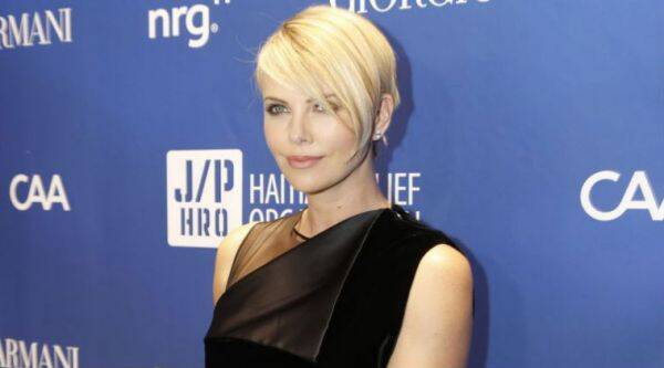 Charlize Theron says she has her moments when she does not like looking in a mirror . (Source: AP)