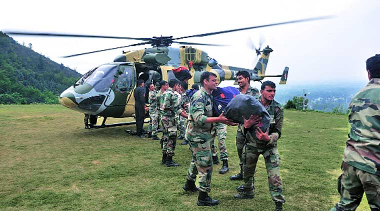 A rescue chopper is loaded with ration. (Source: Express photo)