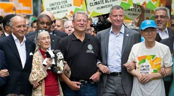 French Foreign Minister Laurent Fabius, from left, primatologist Jane Goodall, former U.S. Vice President Al Gore, New York Mayor Bill de Blasio, and U.N. Secretary General Ban Ki-moon participate in the People's Climate March in New York, Sunday, Sept. 21, 2014. (Source: AP)