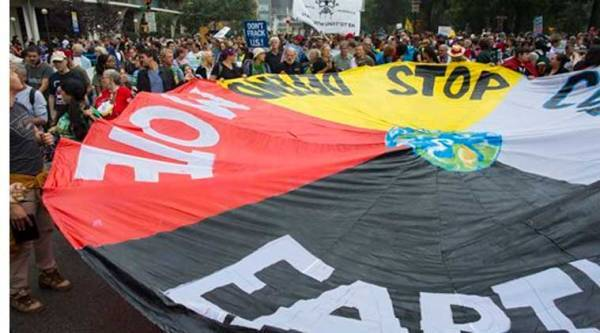Marchers lift a banner during the People's Climate March in New York Sunday, Sept. 21, 2014. (Source: AP)