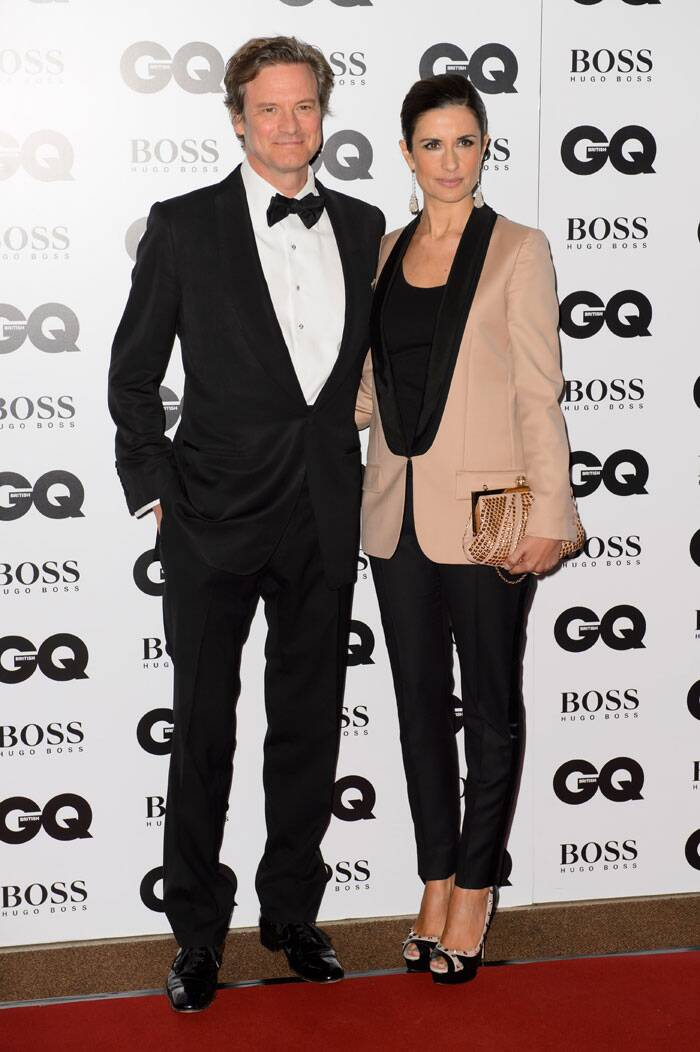Actor Colin Firth was sharp in a tuxedo and was accompanied by his beautiful wife Livia Giuggioli. (Source: AP)