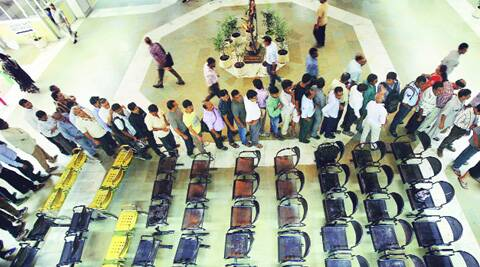 Long queues formed at the DDA headquarters at 8 am, more than an hour before the scheme was launched on Monday. (Source: Express photo by Praveen Khanna)