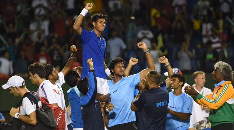 Somdev Devvarman is lifted by his teammates after he stunned Lajovic of Serbia in the ongoing Davis Cup.  (Source: PTI)