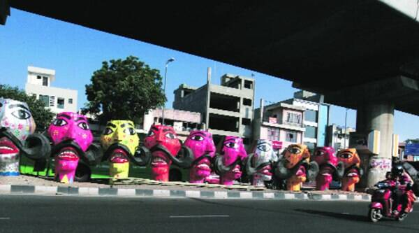 Ravan heads displayed under the Tagore Garden Metro station on Monday. ( Source: Express photo by Renuka Puri )