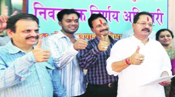Shiv Sena rebel Anant Tare (first from right) filed his nomination as a BJP candidate in Thane, on Saturday.