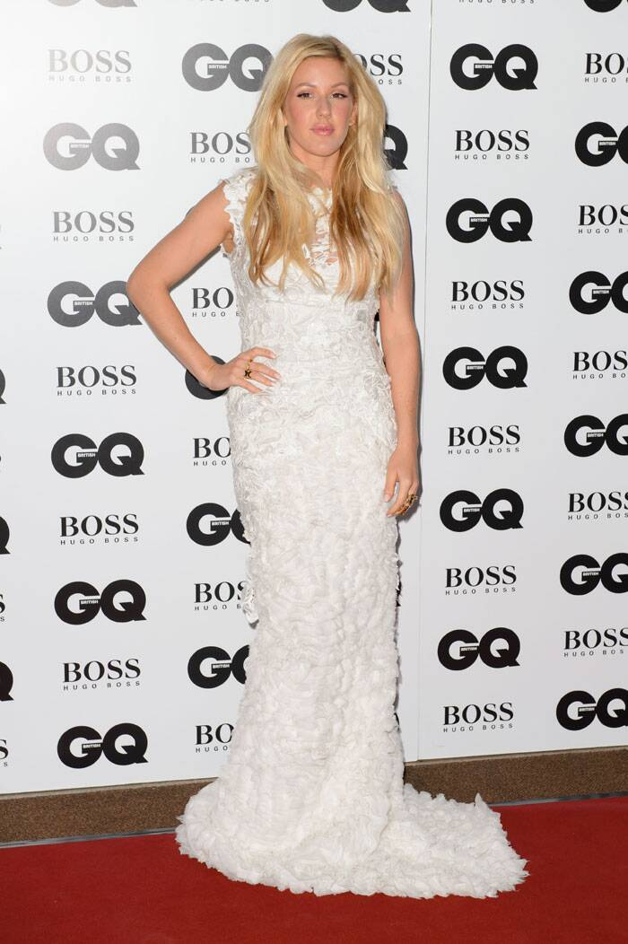 'Burn' singer Ellie Goulding was immaculate in a white lace gown by Ermanno Scervino. (Source: AP)