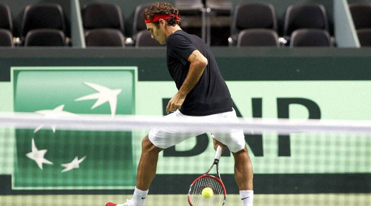 Roger Federer, of Switzerland, returns a ball, during a training session of the Swiss Davis Cup team (Source: AP)