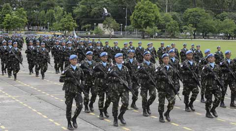 In this Friday, July 18, 2014 photo, a contingent of Philippine U.N. Peacekeepers march past the grandstand during a turnover-of-command ceremony for the new Armed Forces chief at Camp Aguinaldo at suburban Quezon city, northeast of Manila, Philippines. (Source: AP)