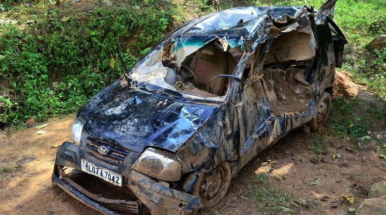 A damaged car after a landslide at Kharkhuta village in North Garo Hills district of Meghalaya. (Source: PTI)